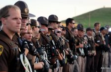 Police officers stand guard at the Dakota Access Pipeline construction site near Cannonball, North Dakota.