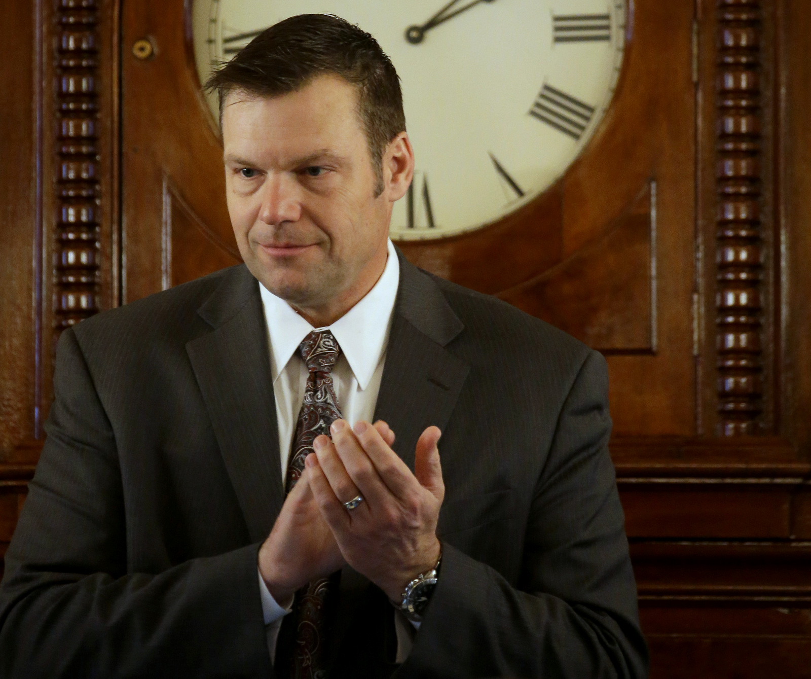 In this Monday, Jan. 12, 2015 photo, Kansas Secretary of State Kris Kobach presides over the Kansas House while new members are sworn in during the opening day of the Kansas legislature in Topeka, Kan. (AP Photo/Charlie Riedel, File)