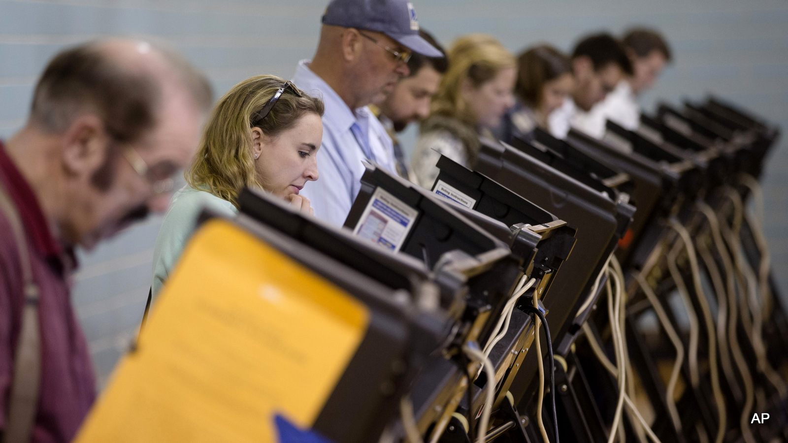 Voters use electronic voting machines at the Schiller Recreation Center polling station on election day, Tuesday, Nov. 3, 2015, in Columbus, Ohio.