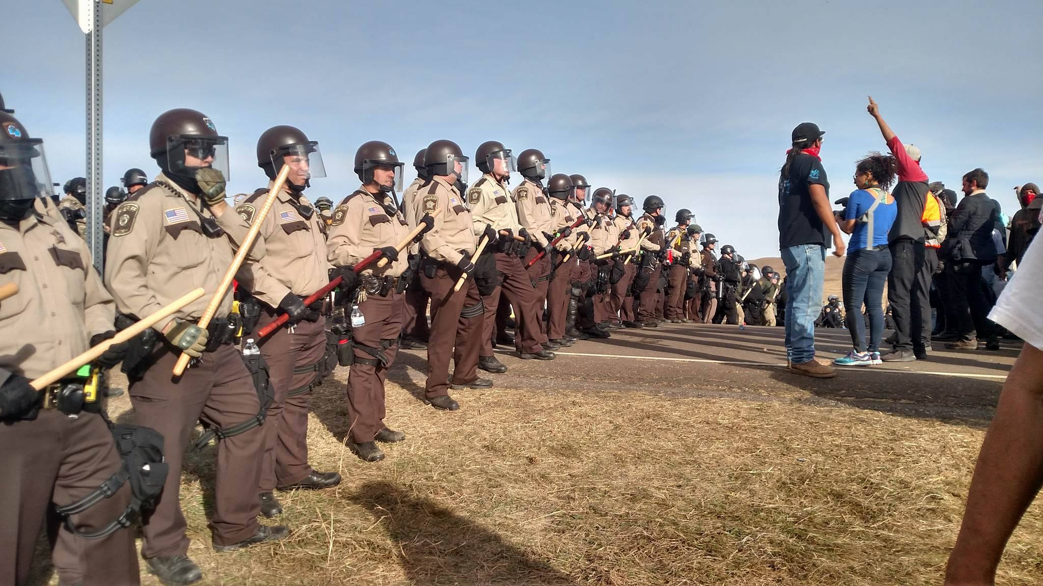 the standing rock struggle to secure clean water a photo essay water protectors face off a police line off north dakota highway 1806 law enforcement