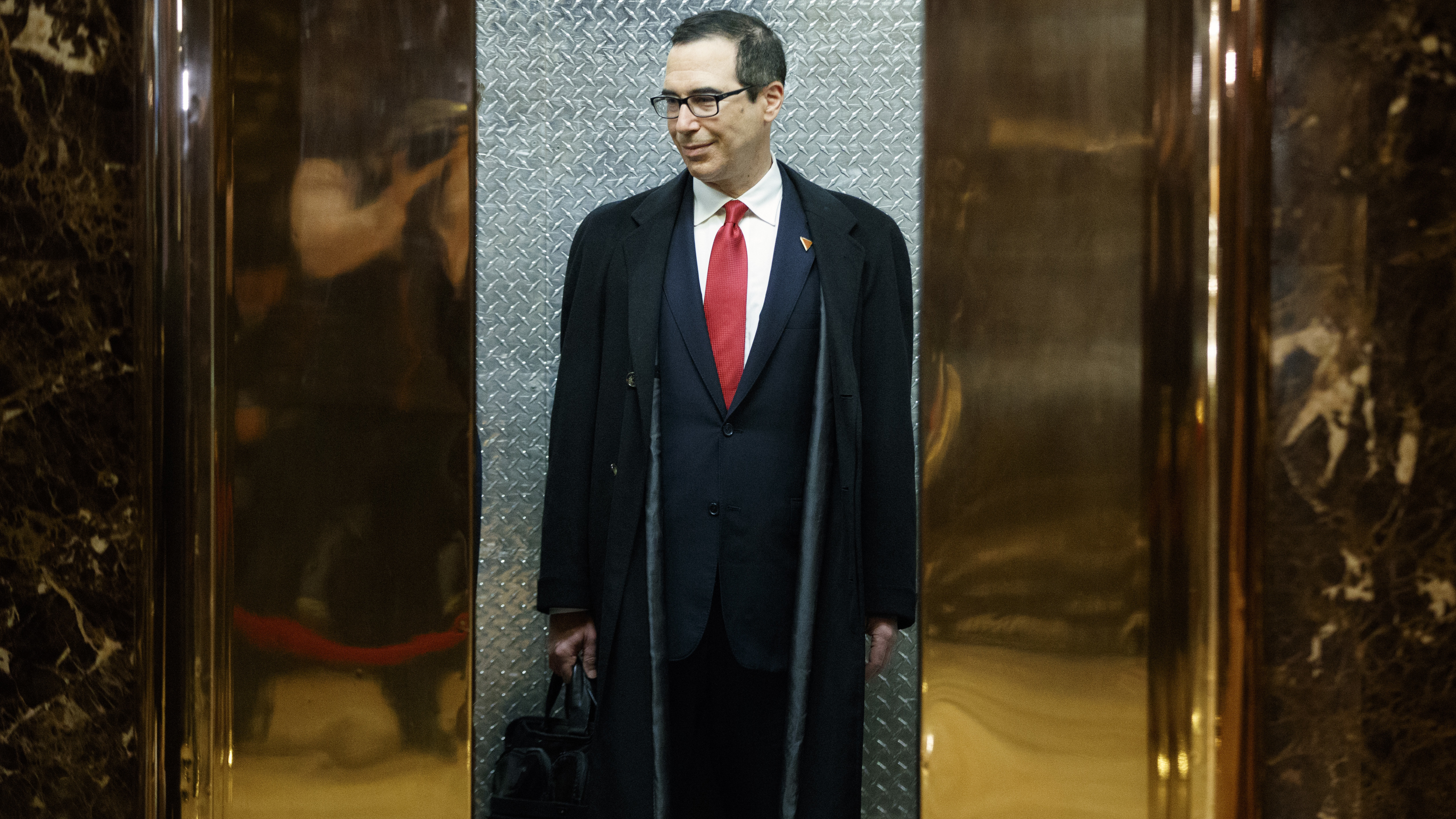 Steven Mnuchin, President-elect Donald Trump's nominee for Treasury Secretary, gets on an elevator after speaking with reporters in the lobby of Trump Tower, Wednesday, Nov. 30, 2016, in New York. (AP Photo/Evan Vucci)