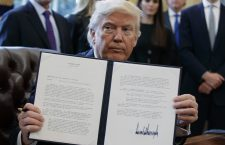 President Donald Trump shows off his signature on an executive order about the Dakota Access pipeline, Tuesday, Jan. 24, 2017, in the Oval Office of the White House in Washington. (AP/Evan Vucci)