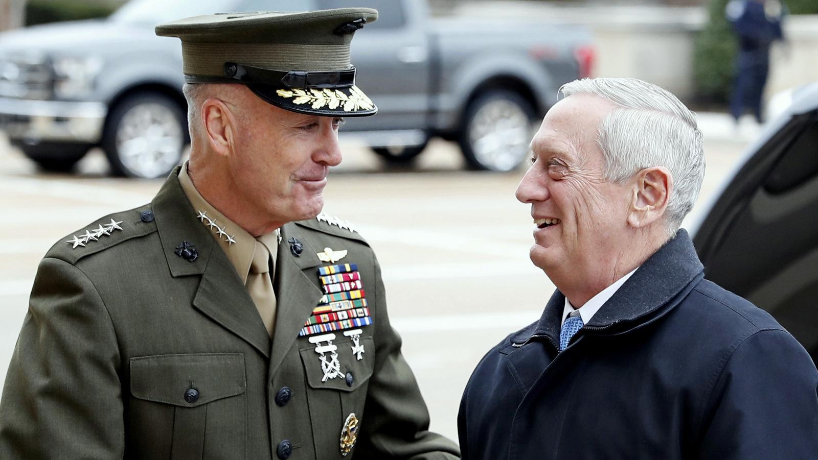 Joint Chiefs Chairman Gen. Joseph Dunford greets Defense Secretary James Mattis at the Pentagon (AP/Alex Brandon)