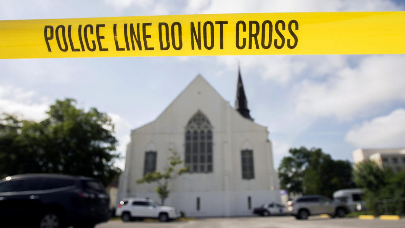 Police tape surrounds the parking lot behind the AME Emanuel Church as FBI forensic experts work the crime scene where nine people where shot by Dylann Storm Roof, 21, in Charleston, S.C. Since the Oklahoma City bombing in 1995, the Southern Poverty Law Center has tracked domestic terrorist plots and attacks in the United States. It lists more than 100, including the slaying of nine black churchgoers during a 2015 prayer meeting in Charleston, S.C. (AP/Stephen B. Morton)