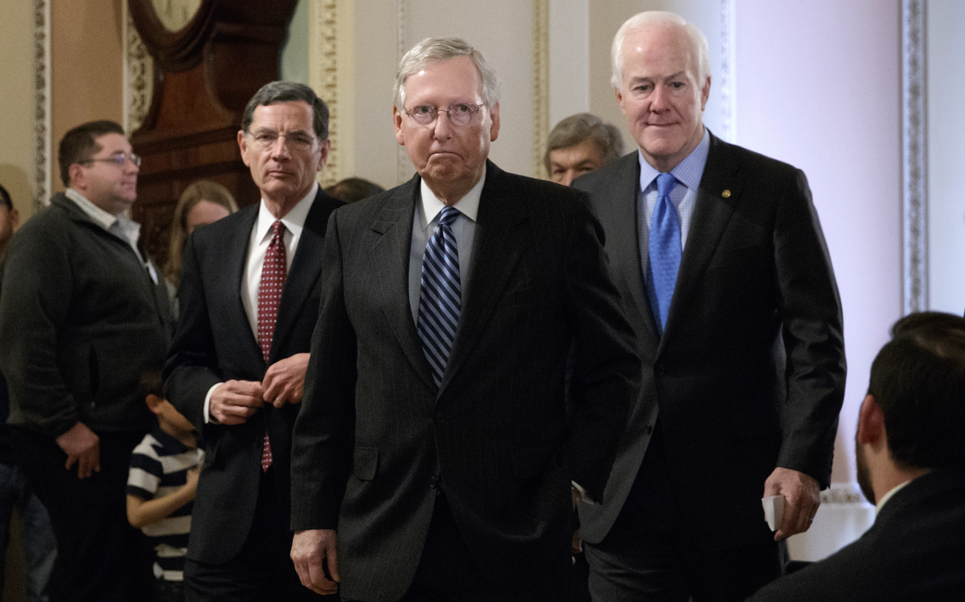 Senate Majority Leader Mitch McConnell, R-Ky., flanked by Sen. John Barrasso, R-Wyo., left, and Majority Whip John Cornyn, R-Texas, arrives to speak with reporters at the Capitol in Washington, Tuesday, March, 14, 2017. The White House and Republican leaders in Congress are scrambling to shore up support for their health care bill after findings from the Congressional Budget Office estimated that 14 million people would lose insurance coverage in the first year alone under the GOP replacement for Obamacare. (AP/J. Scott Applewhite)