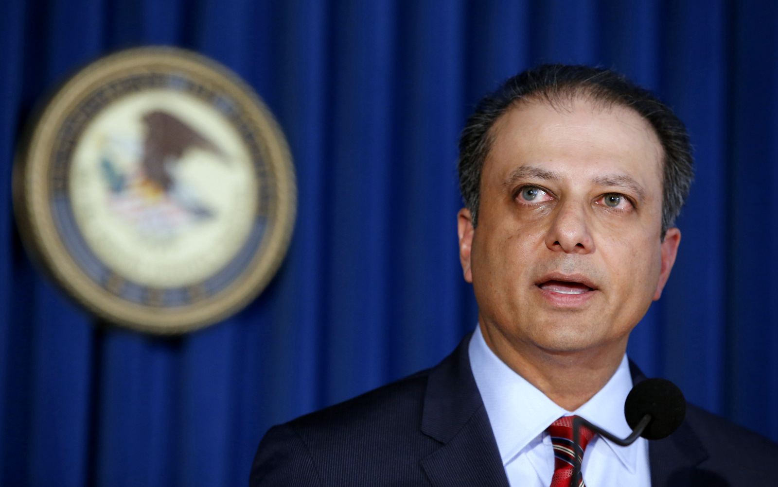 U.S. Attorney Preet Bharara speaks during a news conference in New York.  On Wednesday, March 8, 2017, two days before Attorney General Jeff Sessions gave dozens of the country's top federal prosecutors just hours to resign and clean out their desks. Bharara said on Saturday, March 11, 2017, that he was fired after refusing to resign. (AP/Kathy Willens)