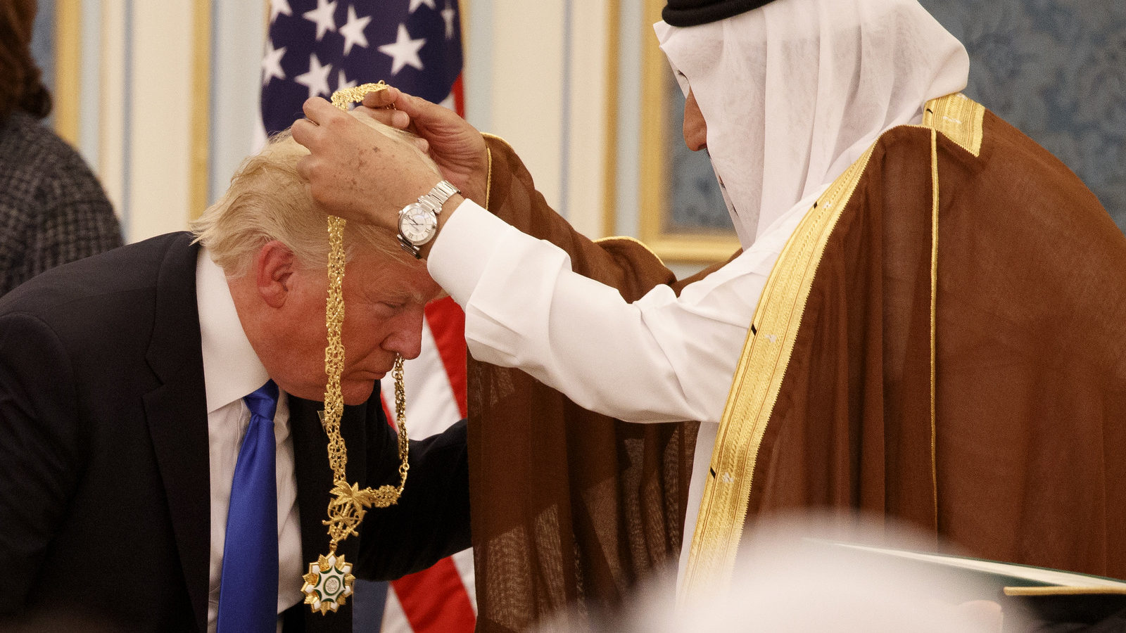Saudi King Salman presents President Donald Trump with The Collar of Abdulaziz Al Saud Medal at the Royal Court Palace, Saturday, May 20, 2017, in Riyadh. (AP/Evan Vucci)