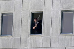 An armed man stands in a window of the parliament building in Tehran, Iran, Wednesday, June 7, 2017. . (Fars News/Omid Vahabzadeh via AP)