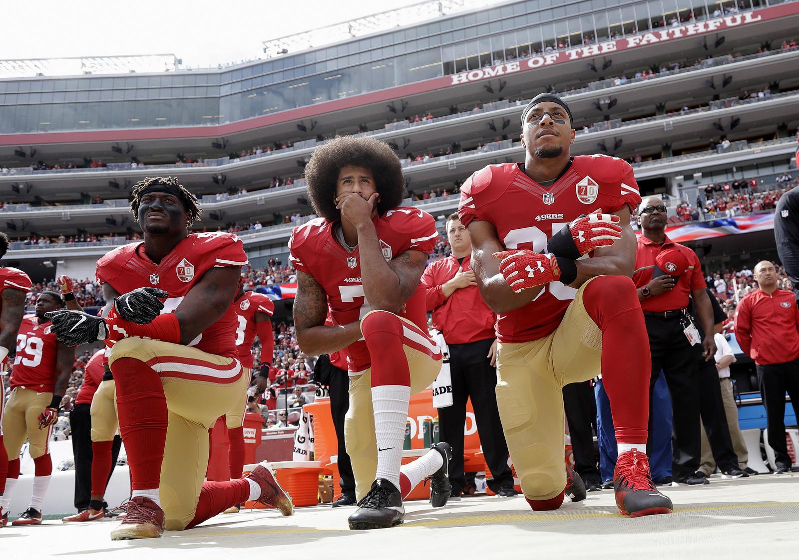 San Francisco 49ers outside linebacker Eli Harold, quarterback Colin Kaepernick and safety Eric Reid kneel during the national anthem before an NFL football game against the Dallas Cowboys in Santa Clara, Calif. (AP/Marcio Jose Sanchez)