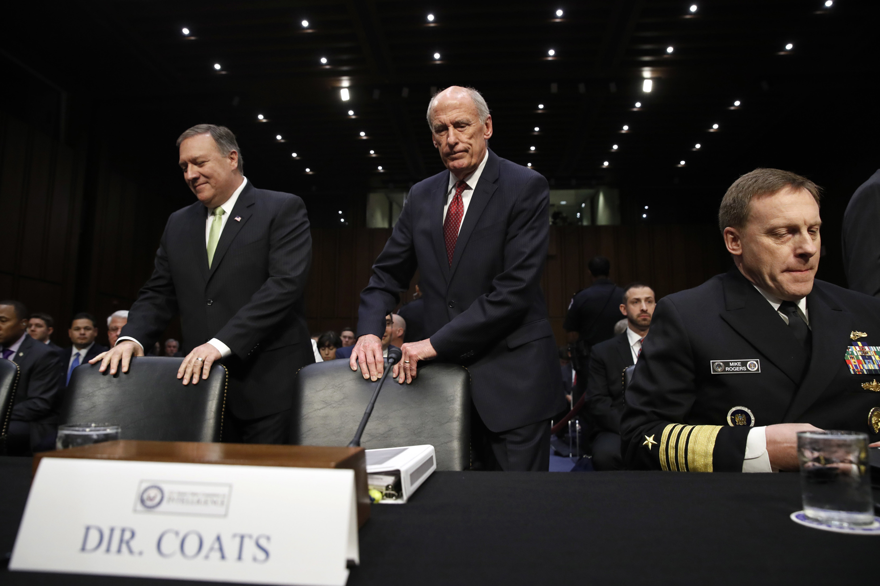 CIA Director Mike Pompeo (left), Director of National Intelligence Dan Coats, and National Security Agency Director Adm. Michael Rogers take their seats on Capitol Hill in Washington, May 11, 2017, prior to testifying before the Senate Intelligence Committee hearing on major threats facing the U.S. (Photo: Jacquelyn Martin/AP)