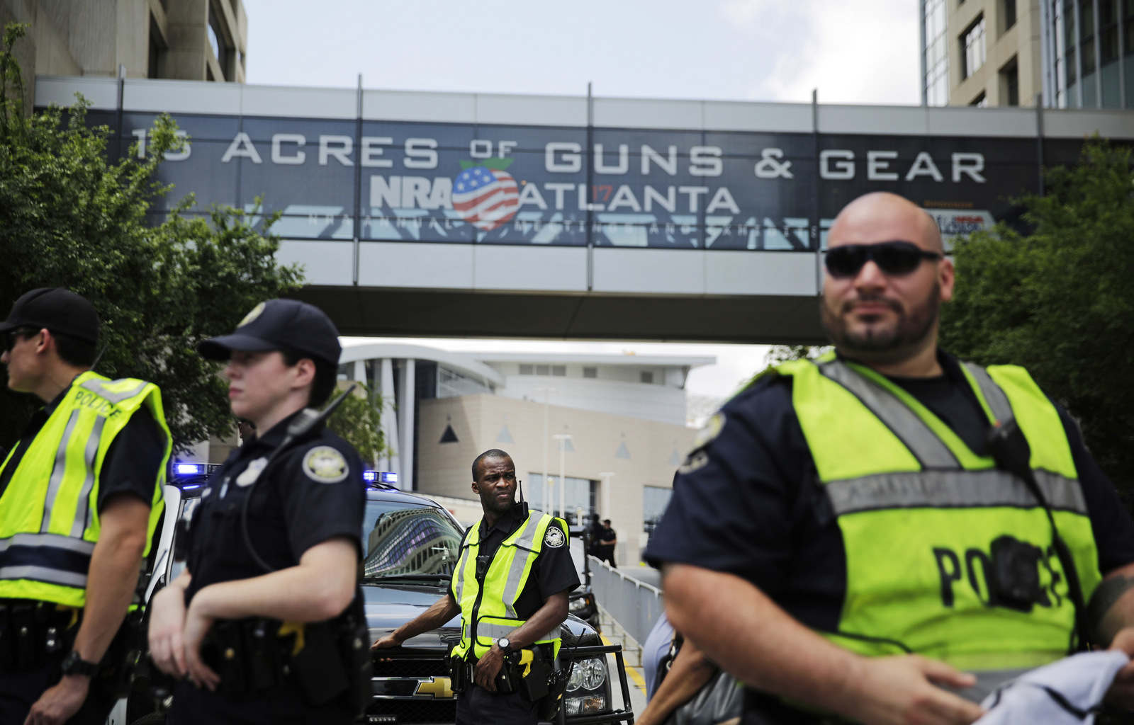 Police stand watch during a protest across the street from the National Rifle Association's annual convention where Donald Trump was scheduled to speak in Atlanta, April 28, 2017. (AP/David Goldman)
