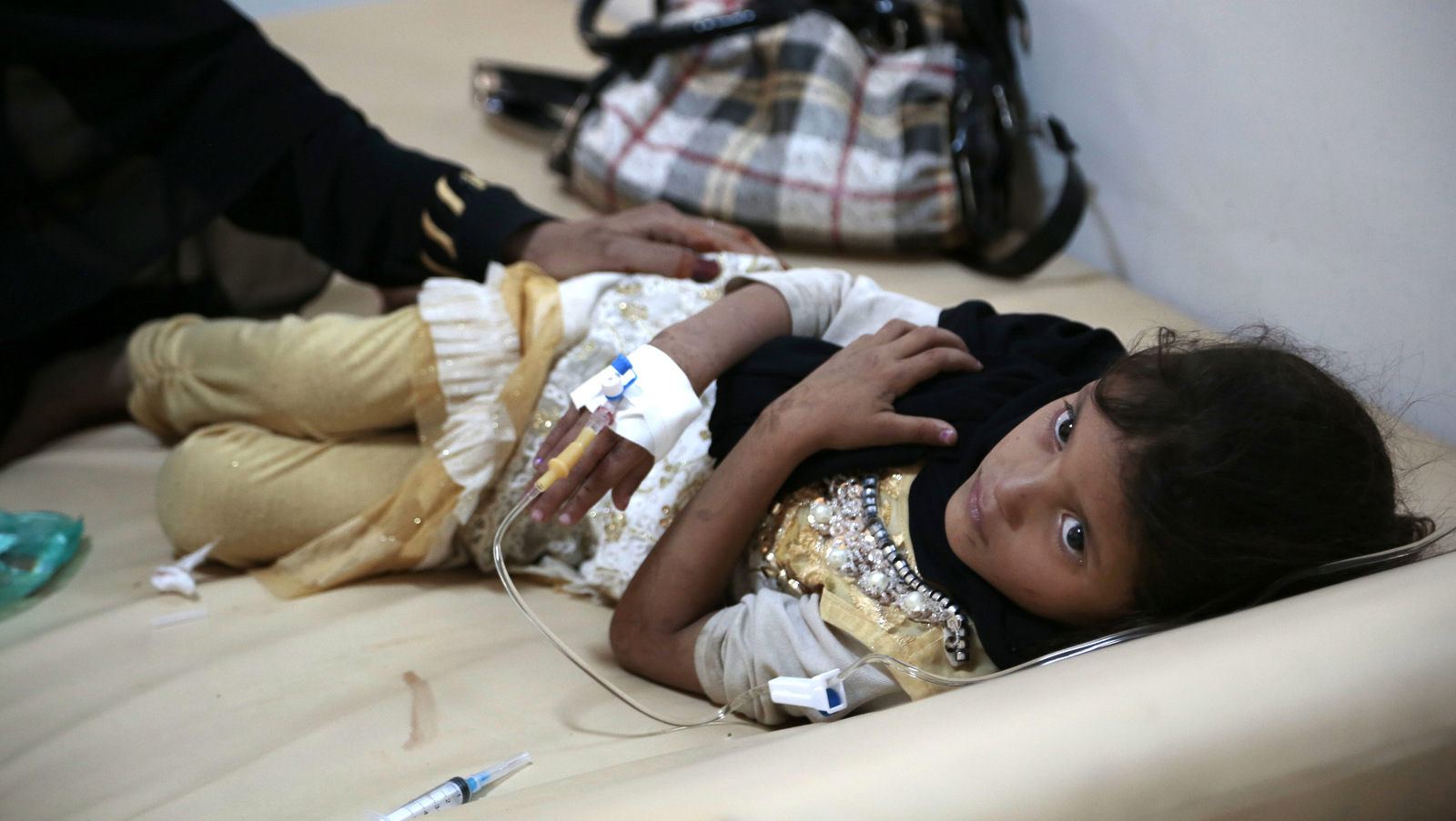 A girl is treated for a suspected cholera infection at a hospital in Sanaa, Yemen. The World Health Organization says a rapidly spreading cholera outbreak in Yemen has claimed thousands of lives since April and is suspected of affecting 246,000 people. (AP/Hani Mohammed)