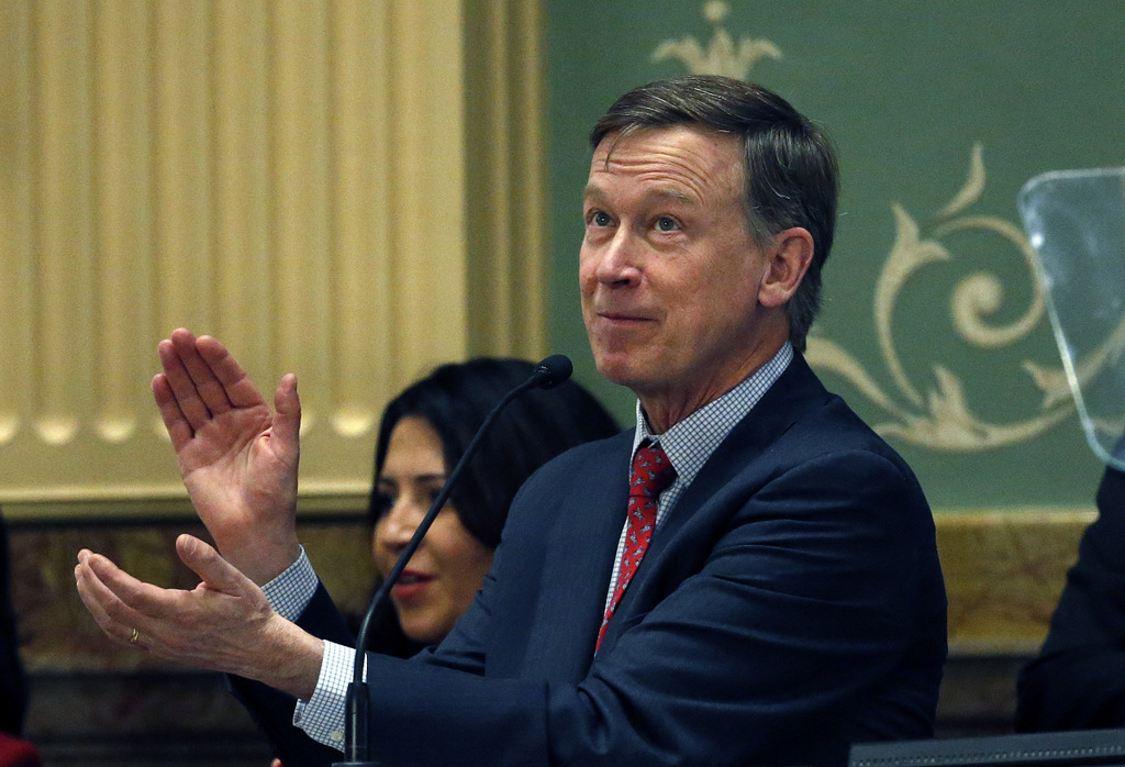 "Colorado Gov. John Hickenlooper applauds as he delivers his annual State of the State address in Denver. Dissatisfied with Democratic fortunes in the Trump era, a group of prominent Democrats is forming an organization outside the formal party structure with the goal of winning again in Republican-dominated middle America. Calling itself ""New Democracy."" (AP/Brennan Linsley)"