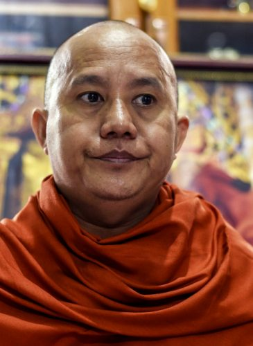 In this Nov. 12, 2016 photo, Wirathu, a high-profile leader of the Myanmar Buddhist organization known as Ma Ba Tha, is interviewed at his monastery in Mandalay, Myanmar. The nationalist monk is blamed for whipping up bloody anti-Muslim fervor, and said he feels vindicated by the election of Donald Trump. (AP Photo/Aung Naing Soe)
