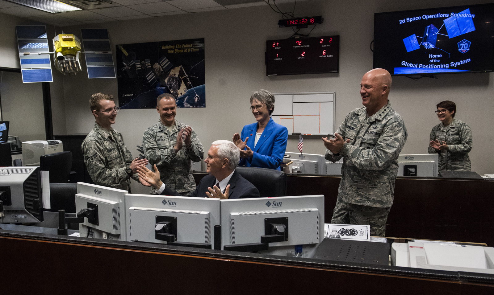 Vice President Mike Pence learns how to send a command to a satellite dish while touring the 2d Space Operations Squadron, Home of the Global Positioning System, at Schriever Air Force Base Friday, June 23, 2017, during his visit to Colorado Springs, Colo. (Christian Murdock/The Gazette via AP)