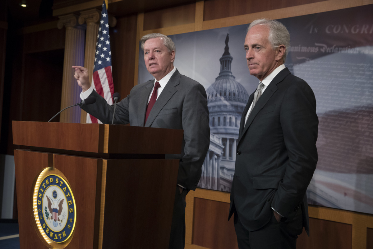 """Sen. Lindsey Graham, R-S.C., left, chairman of the Senate Judiciary subcommittee on Crime and Terrorism, with Senate Foreign Relations Committee Chairman Sen. Bob Corker, R-Tenn., speaks with reporters on Capitol Hill in Washington,, Aug. 3, 2017, after the approval of the """"Taylor Force Act,"""" which suspends U.S. financial aid to the Palestinian Authority until it """"stops rewarding Palestinians who kill American and Israeli citizens."""" (AP/J. Scott Applewhite)"""