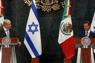 Israel's Prime Minister Benjamin Netanyahu, left, and Mexico's President Enrique Pena Nieto address the media during a joint statement at the Los Pinos presidential residence in Mexico City, Thursday Sept. 14, 2017. Netanyahu is wrapping-up in Mexico his Latin America trip that included also Argentina and Colombia.(AP Photo/Eduardo Verdugo)