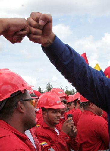 Venezuelan President Nicolas Maduro fist bumps a worker of the state-run oil company PDVSA during a visit to the Orinoco oil belt in Venezuela in 2013. (Photo: Miraflores/AP)