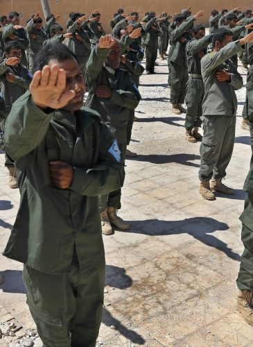 Syrian Internal Security Forces are sworn in during their graduation ceremony, at Ain Issa desert base, in Raqqa province, northeast Syria, Thursday, July 20, 2017. (AP Photo/Hussein Malla)
