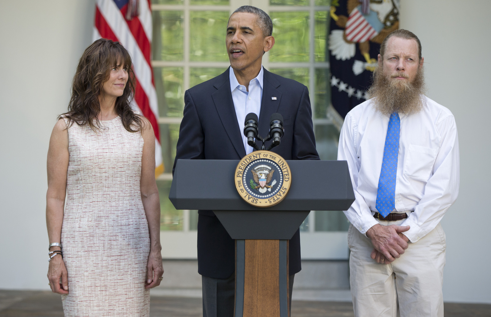 President Barack Obama, accompanied by Jani Bergdahl, left, and Bob Bergdahl, speaks during a news conference in the Rose Garden of the White House in Washington on Saturday, May 31, 2014 about the release of their son, U.S. Army Sgt. Bowe Bergdahl. (AP/Carolyn Kaster)