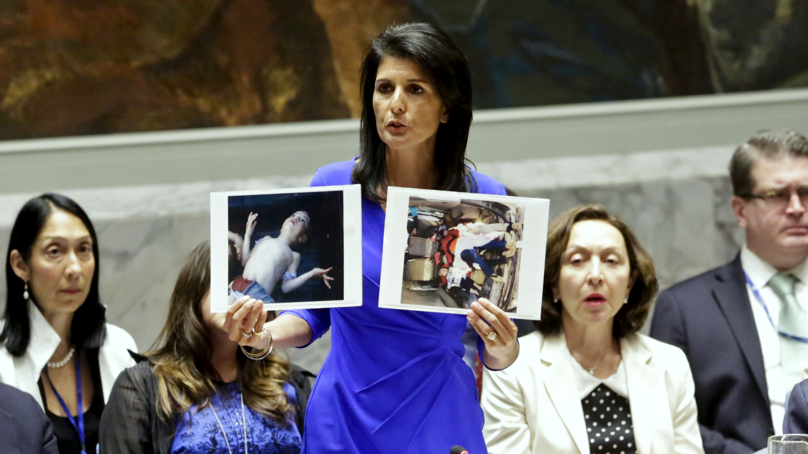 Nikki Haley, United States' Ambassador United Nations, shows pictures of Syrian victims of chemical attacks as she addresses a meeting of the Security Council on Syria at U.N. headquarters, April 5, 2017. (AP/Bebeto Matthews)
