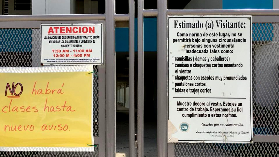 A sign informs residents that their local school is closed until further notice in the town of Las Piedras, Puerto Rico. (Déborah Berman-Santana)
