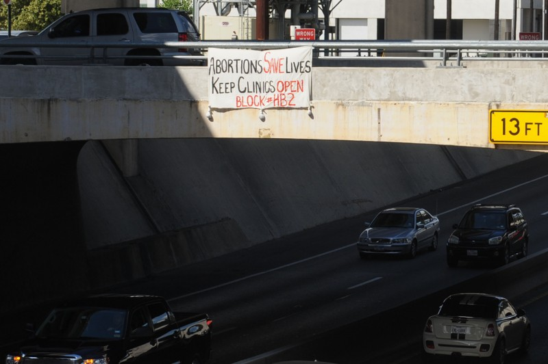 This banner hung over I35 in Austin, Texas on September 11, 2014. The Texas Omnibus Abortion Bill (HB2) Returns to court Friday at the 5th Circuit Court of Appeals. If upheld, it could close all but 8 clinics providing abortion in Texas. (Photo: John Jack Anderson)