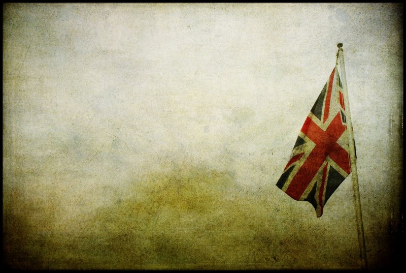 A Union Jack flag hangs against a desolate blank background.