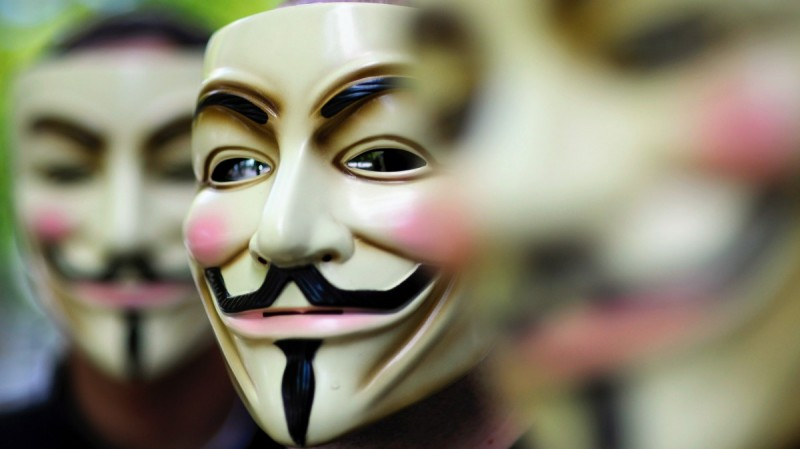 """Activists of the international network """"Anonymous"""" pose behind their masks."""