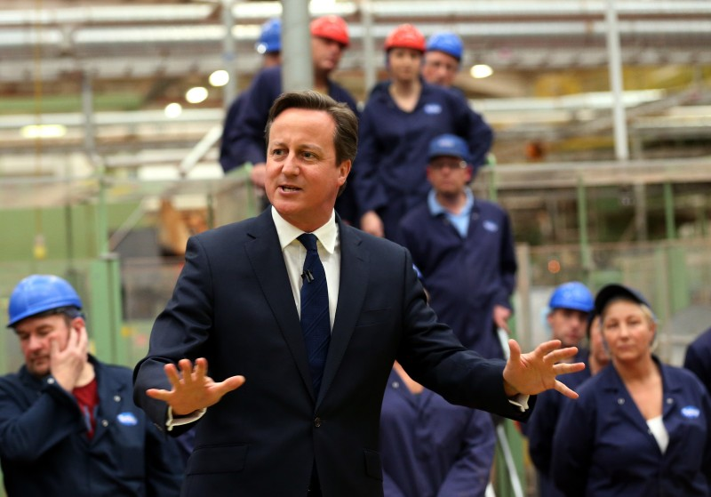 Britain's Prime Minister David Cameron talks to staff during a visit to a tea factory in Stockton-on-Tees, England, Tuesday May 12, 2015, his first engagement outside London since winning the general election. (Scott Heppell/Pool Photo via AP)
