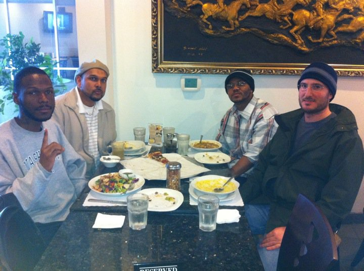 Sharing a meal with Malcolm Shabazz. (Professor ALI)
