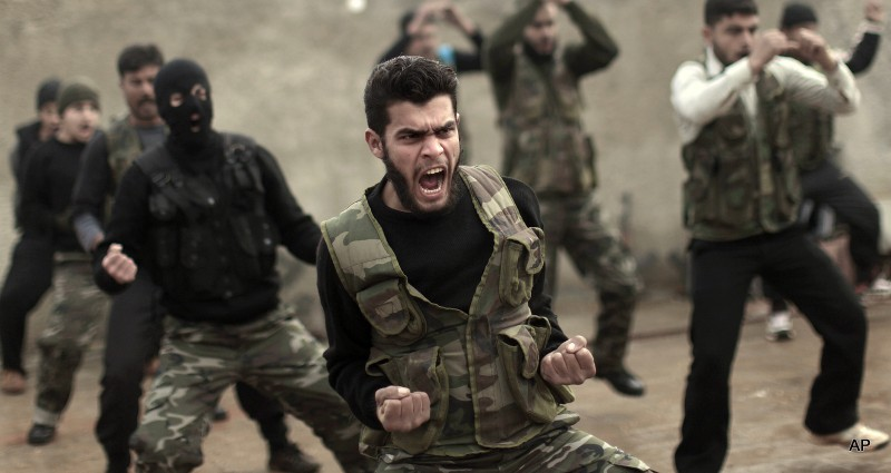 Syrian rebels attend a training session in Maaret Ikhwan near Idlib, Syria. Fewer than 100 Syrian rebels are currently being trained by the U.S. military to fight the Islamic State group, a tiny total for a sputtering program with a stated goal of producing 5,400 fighters a year. The training effort is moving so slowly that critics question whether it can produce enough capable fighters quickly enough to make a difference. Military officials said this past week that they still hope for 3,000 by year's end. Privately, they acknowledge the trend is moving in the wrong direction.