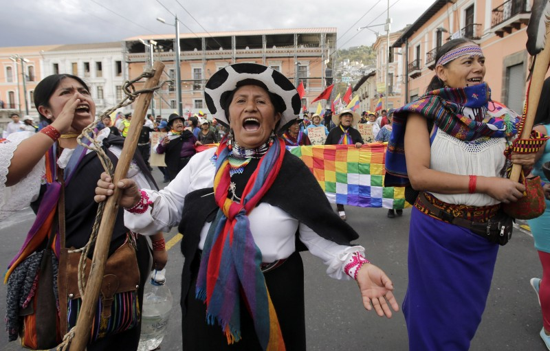 Indian women lead a march as they arrive to Quito during a protest called by the Confederation of Indian Nationalities of Ecuador, in Quito, Ecuador, Wednesday, Aug. 12, 2015. Demonstrators converged on the Capital from around the country and will participate in a national strike on Thursday to protest against policies of president Rafael Correa. (AP Photo/Dolores Ochoa)