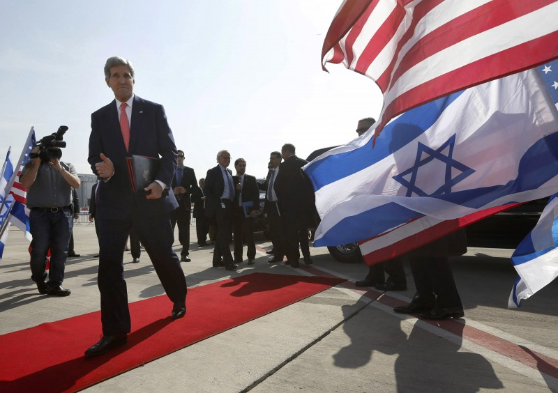 "In this Friday, Nov. 8, 2013 file photo, U.S. Secretary of State John Kerry walks to his plane after meeting with Israeli Prime Minister Benjamin Netanyahu in Tel Aviv, Israel. In an unexpected consequence of the global diplomacy over Iran, Israel and Gulf Arab states led by Saudi Arabia are boosting back-channel contacts and finding increasing common ground over their mutual dismay with Tehran's drive to mend ties with the West and reach a nuclear deal. The ""strange alliance"" _ in the word of one former diplomat _ highlights how the ripples from Iran are driving some allies apart while pushing foes closer. It also highlights the Sunni world's distress at the possibility of a bomb in the hands of a Shiite power.(AP Photo/Jason Reed, Pool, File)"