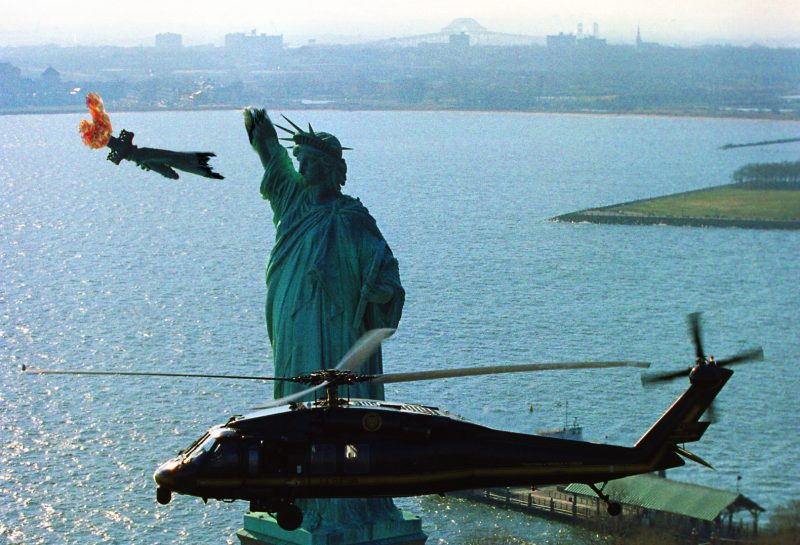 """""""Liberty In Ruins"""" -- an image of a helicopter flying past the ruins of the Statue of Liberty. (Jakob Reimann)"""