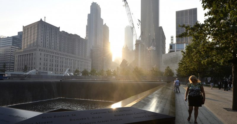 A woman walks along the edge of the North Pool at the 9/11 Memorial during a ceremony marking the 12th anniversary of the 9/11 attacks on the World Trade Center, in New York, Wednesday, Sept. 11, 2013. (AP Photo/Justin Lane, Pool)