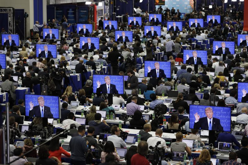 Republican presidential candidate Donald Trump is seen on screens in the media center during the presidential debate between Trump and Democratic presidential candidate Hillary Clinton at Hofstra University, Monday, Sept. 26, 2016, in Hempstead, N.Y. (AP Photo/John Locher)