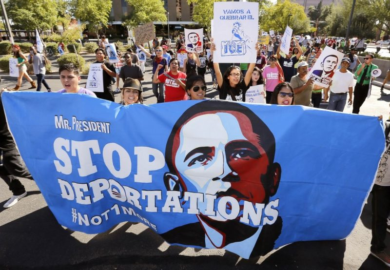 "Upset with President Barack Obama's immigration policy, about 250 people march to the U.S. Immigrations and Customs Enforcement office with a goal of stopping future deportations on Monday Oct. 14, 2013, in Phoenix. The protesters chanted ""no more deportations"" and ""shut down ICE."" (AP Photo/Ross D. Franklin)"
