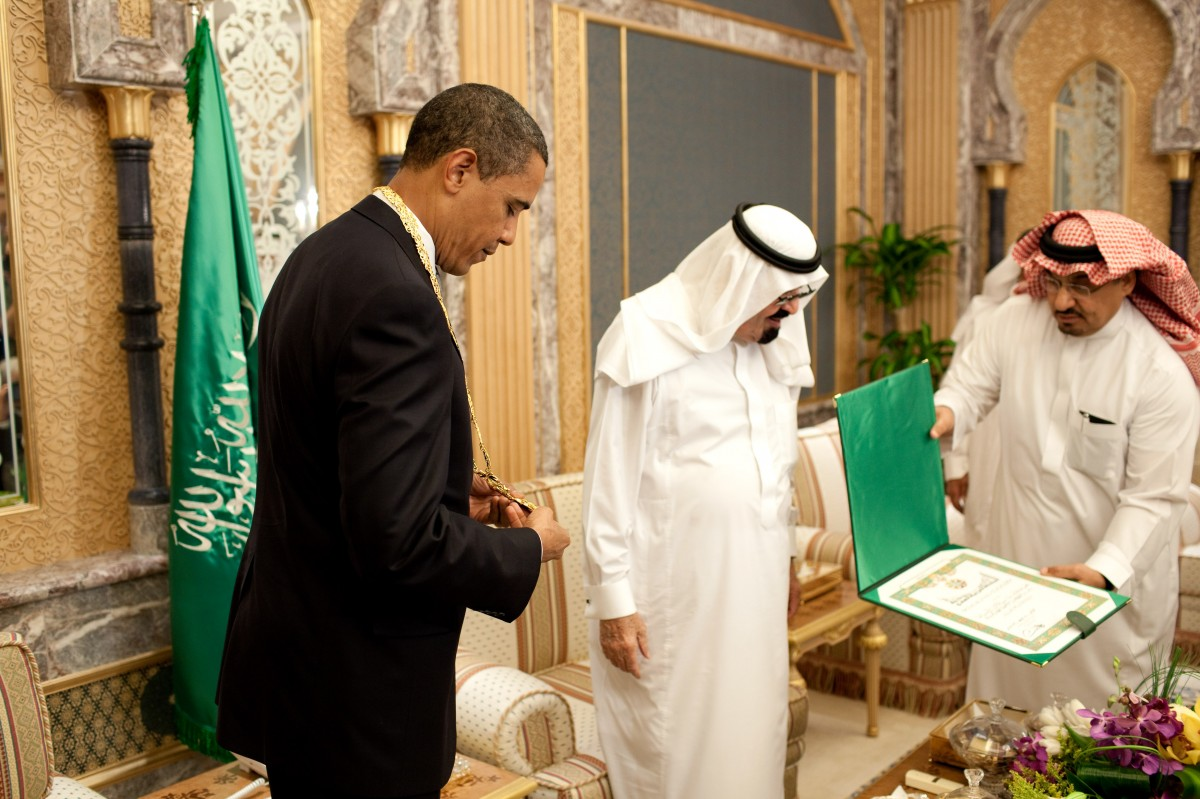 President Barack Obama looks at the King Abdul Aziz Order of Merit presented to him by Saudi King Abdullah bin Abdul Aziz at the start of their bilateral meeting at the King's Farm in Riyadh, Saudi Arabia, June 3, 2009. The medal is Saudi Arabia's highest honor. (Official White House photo by Pete Souza)