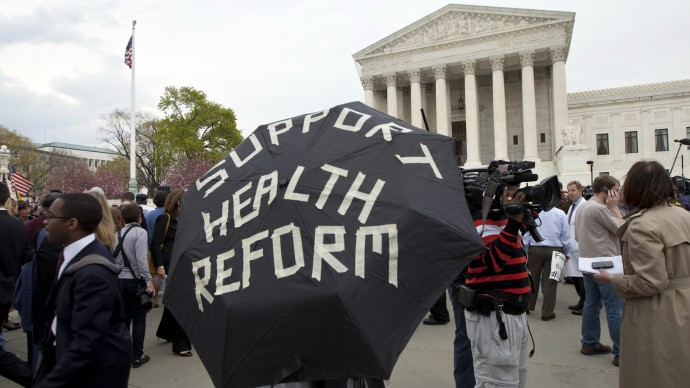 Protesters continue their stance at the steps of the U.S. Supreme Court in Washington, D.C., March 28, 2012. (Mannie Garcia/MintPress)