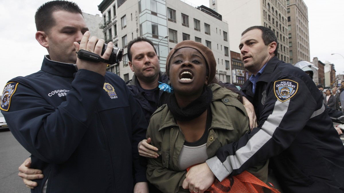 Police officers detain a Occupy Wall Street activist during a march to call for NYPD Police Commissioner Ray Kelly's immediate resignation, Saturday, March 24, 2012 in New York. (AP Photo/Mary Altaffer)