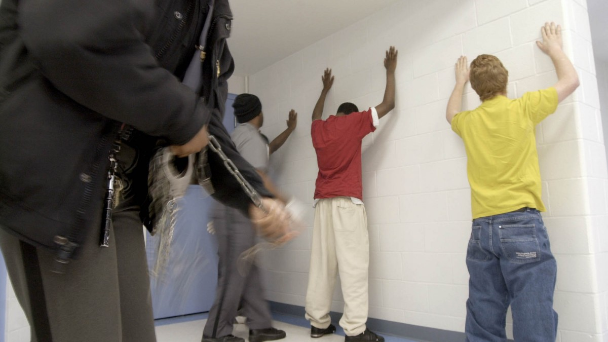 New prisoners at the Department of Youth Services Detention Center begin the intake process by being searched Thursday, Jan. 31, 2002. (AP Photo/Will Shilling)