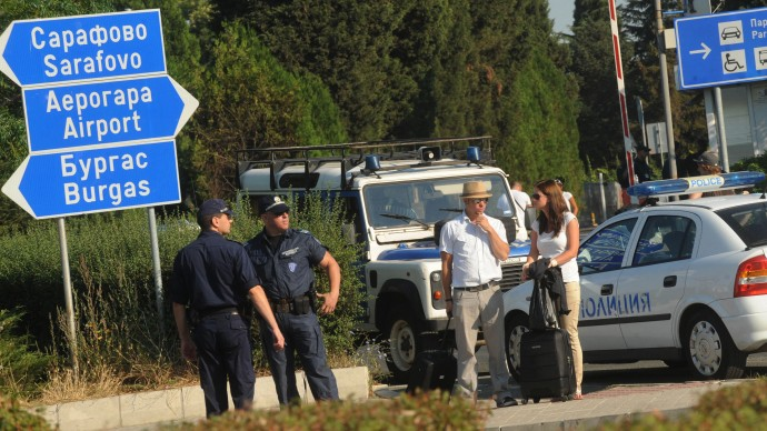 In this Thursday, July 19, 2012 file photo, foreign tourists wait to pass as police block the entrance of Burgas airport, Bulgaria, a day after a deadly suicide attack on a bus full of Israeli vacationers. Israel's prime minister said Sunday, July 22, 2012 that his country is on alert for plots to kill more of its citizens overseas, after speculation that last week's deadly bombing of a tour bus in Bulgaria was a rehearsal for a spectacular attack on Israel's Olympics team. (AP Photo, File)