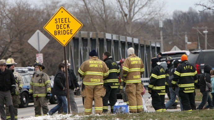 Lake Rd. residents are evacuated from the neighborhood where two Webster firefighters were killed and two others wounded after a gunman opened fire at a blaze. (AP Photo/Democrat & Chronicle, Max Schulte)
