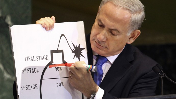 In this Thursday, Sept. 27, 2012 file photo, Israeli Prime Minister Benjamin Netanyahu uses a red marker as he on a diagram of a bomb as he describes his concerns over Iran's nuclear ambitions during his address to the 67th session of the United Nations General Assembly at U.N. headquarters. (AP Photo/Seth Wenig)