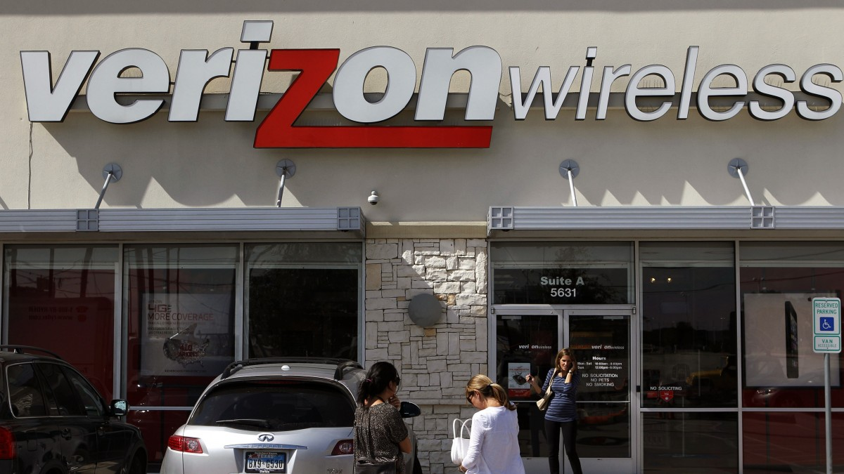 In this Wednesday, Oct. 17, 2012, file photo, customers walk into a Verizon Wireless store in Dallas. (AP Photo/LM Otero, File)