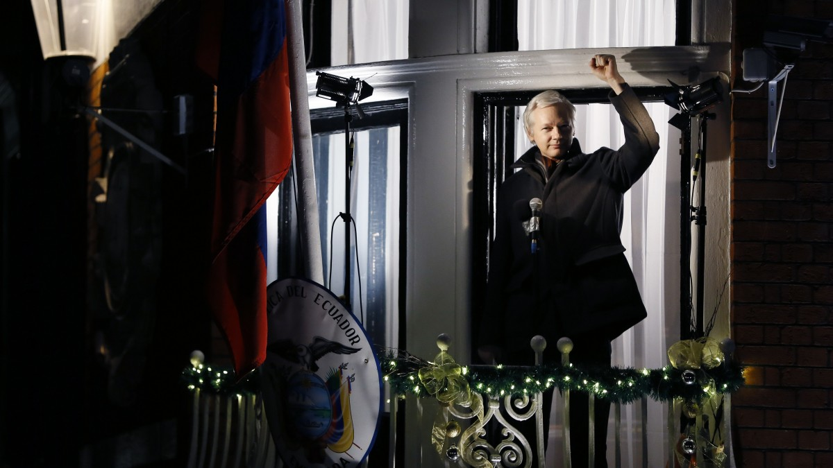 Julian Assange, founder of WikiLeaks, gestures as he speaks to the media and members of the public from a balcony at the Ecuadorian Embassy in London, where he has been taking refuge to avoid extradiction to Sweden. His WikiLeaks Party is in the running to win Senate seats in Australia, according to polls. (AP Photo/Kirsty Wigglesworth)