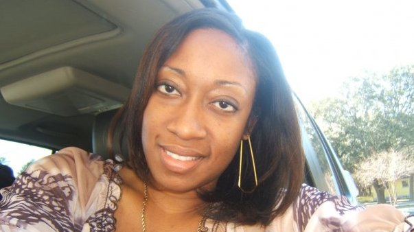 This photo shows Marissa Alexander in her car in Tampa, Fla. Alexander had never been arrested before she fired a bullet at a wall one day in 2010 to scare off her husband when she felt he was threatening her. Nobody got hurt, but this month a northeast Florida judge was bound by state law to sentence her to 20 years in prison. (AP Photo/Lincoln B. Alexander)