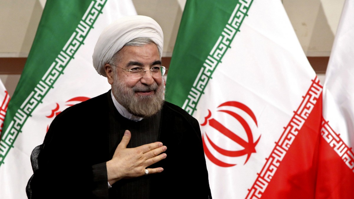 In this Monday, June 17, 2013 photo, Iranian President-elect Hasan Rouhani places his hand on his heart as a sign of respect after speaking at a news conference, in Tehran, Iran. (AP/Ebrahim Noroozi)