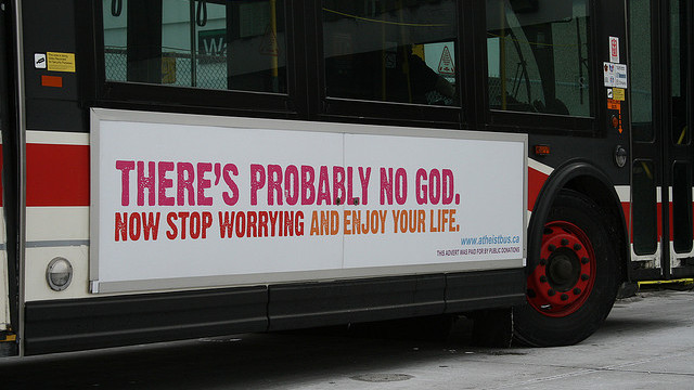"A Canadian bus with a sign reading ""There's probably no God, no stop worrying and enjoy your life"" on the side, in light of Atheism. (Photo/Athiest Bus Canada via Flickr)"
